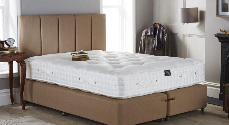 A kingsize mattress in a bedroom