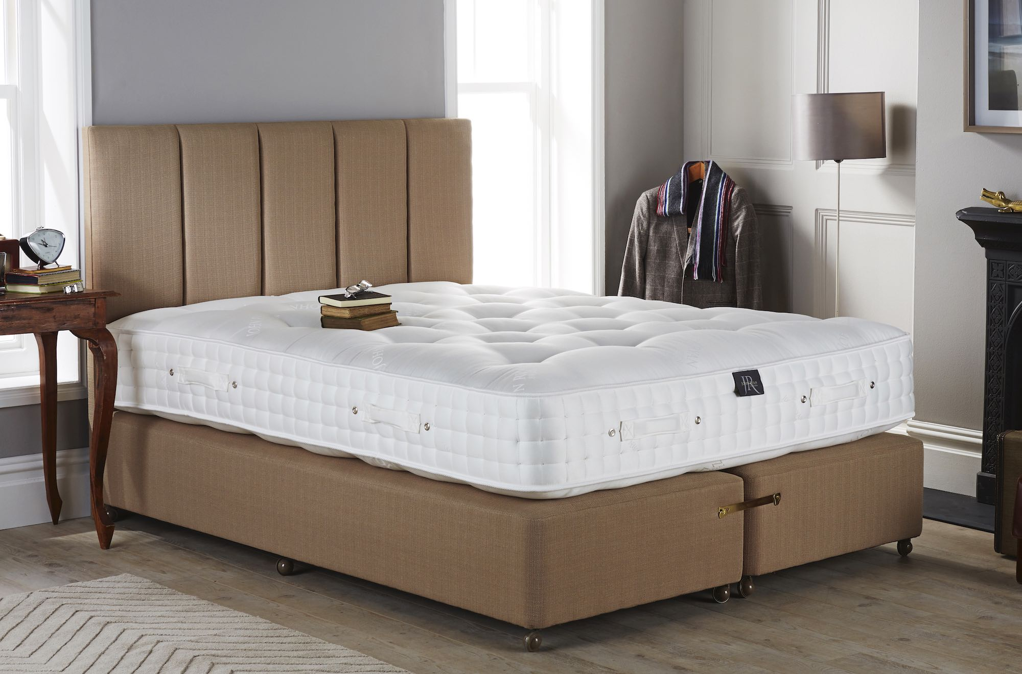 A kingsize mattress in a bedroom