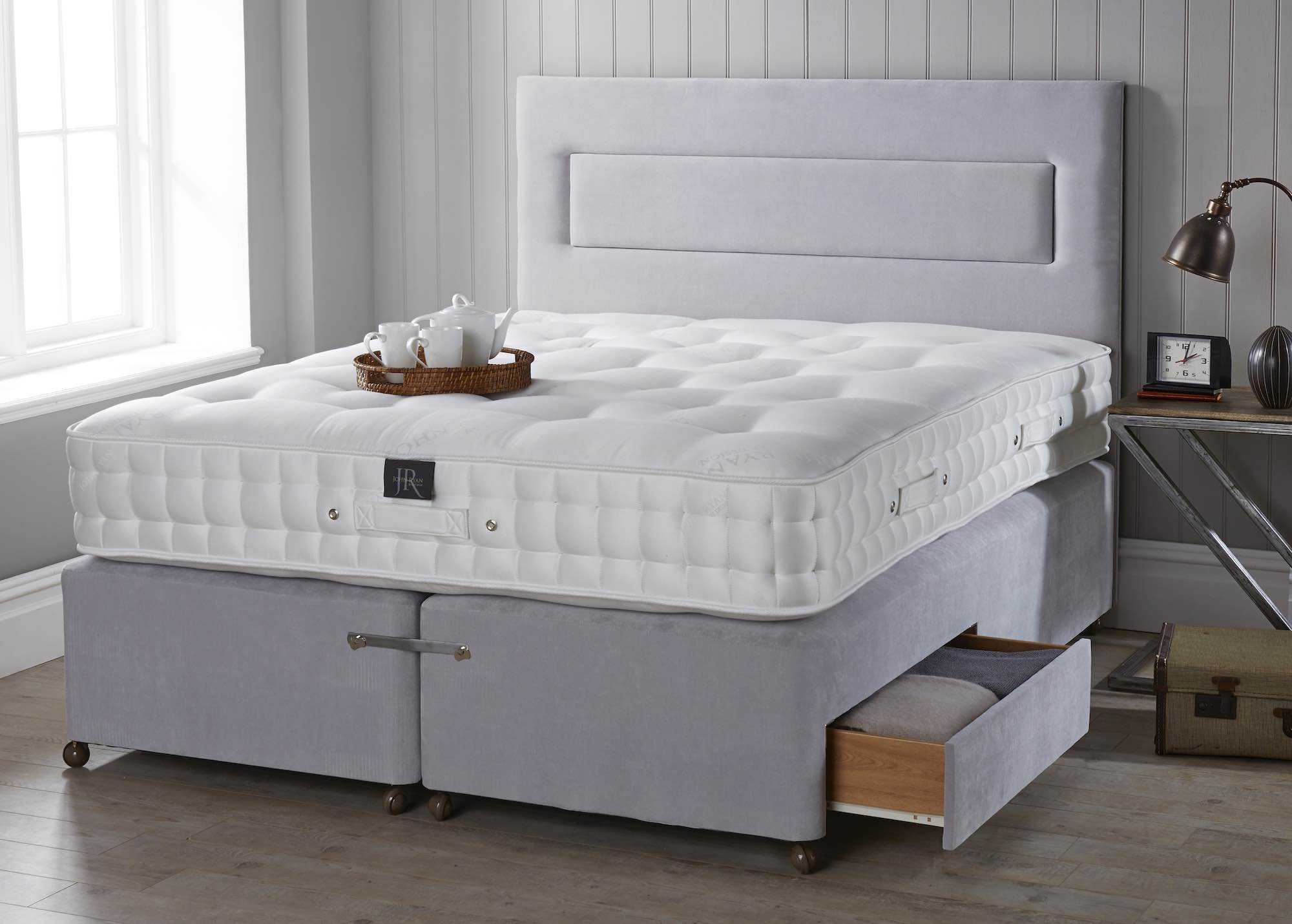 A thick mattress on a divan base