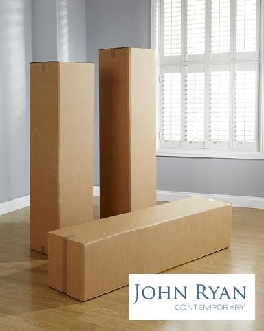John Ryan unwrapping Boxes