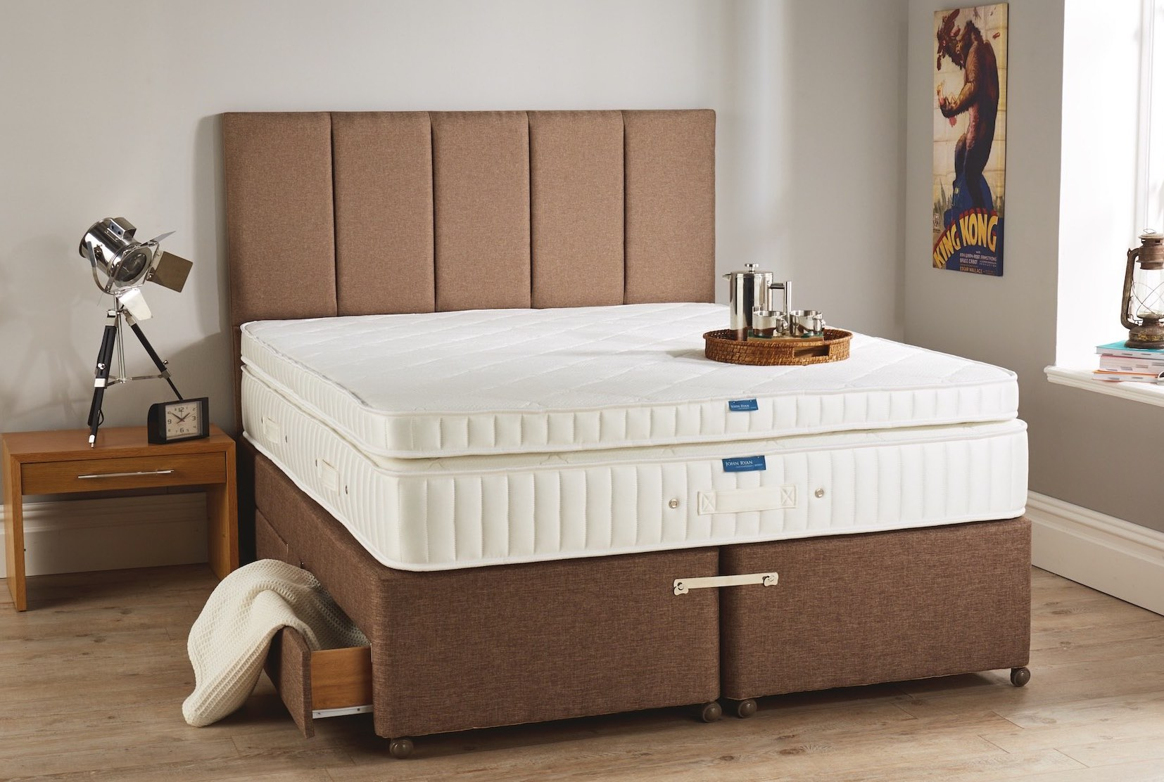 A deep mattress with a mattress topper on top