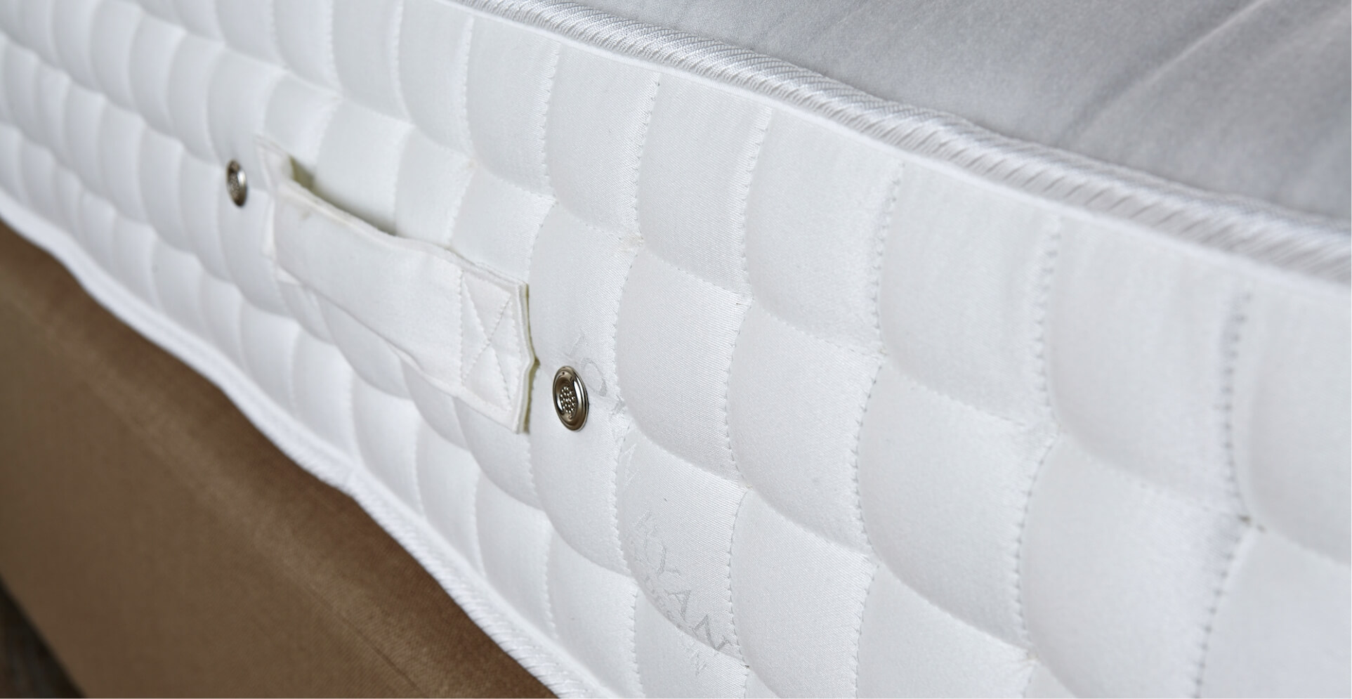 A white mattress viewed from the side