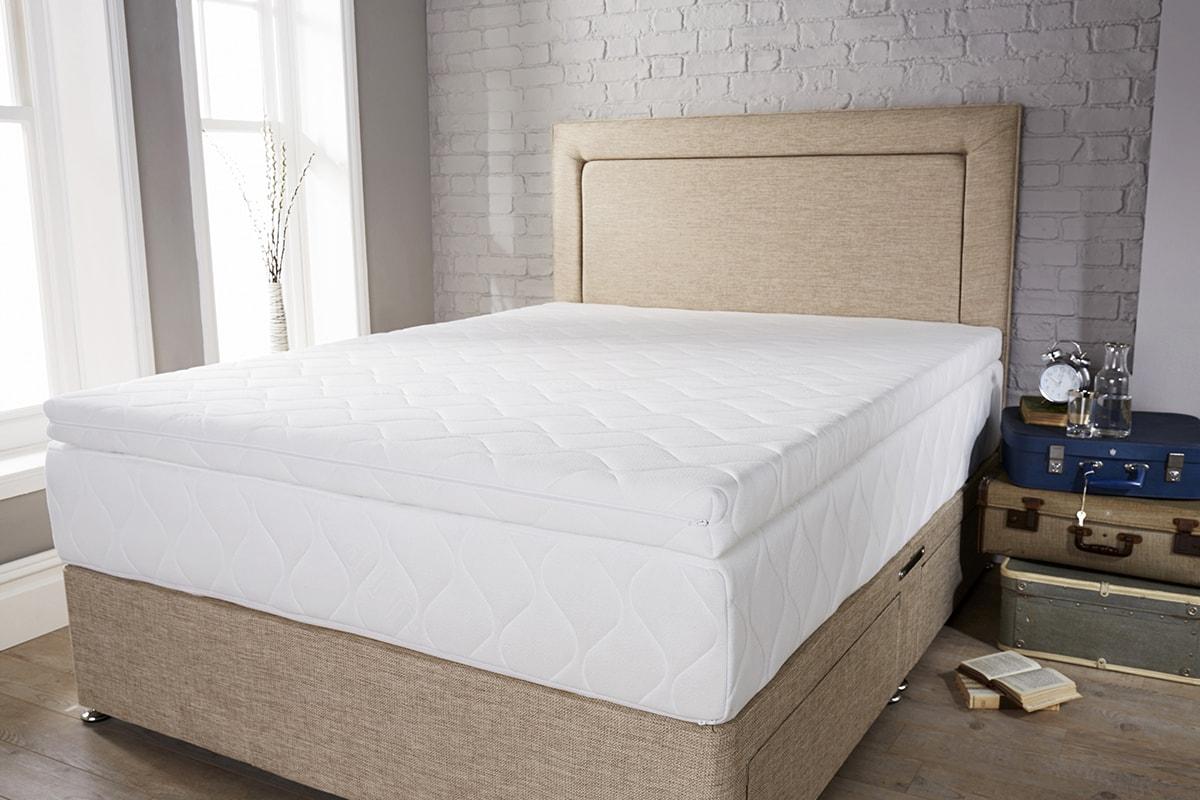 Hybrid 5 mattress on an Origins platform base in cocktail straw with forbes headboard