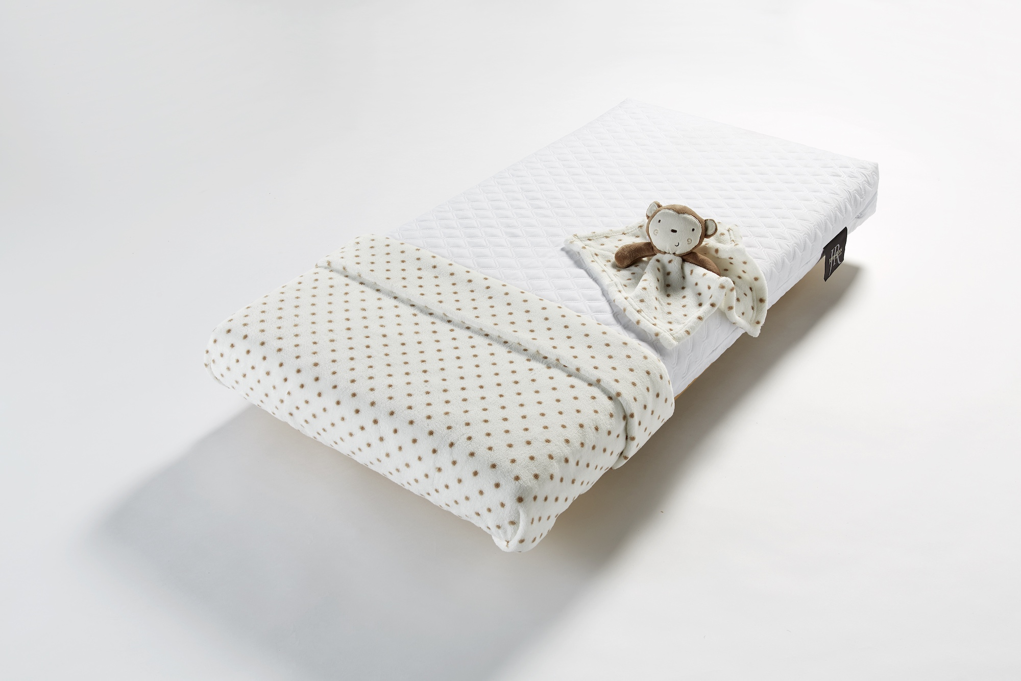 John Ryan By Design Cot mattress with polka dot blanket