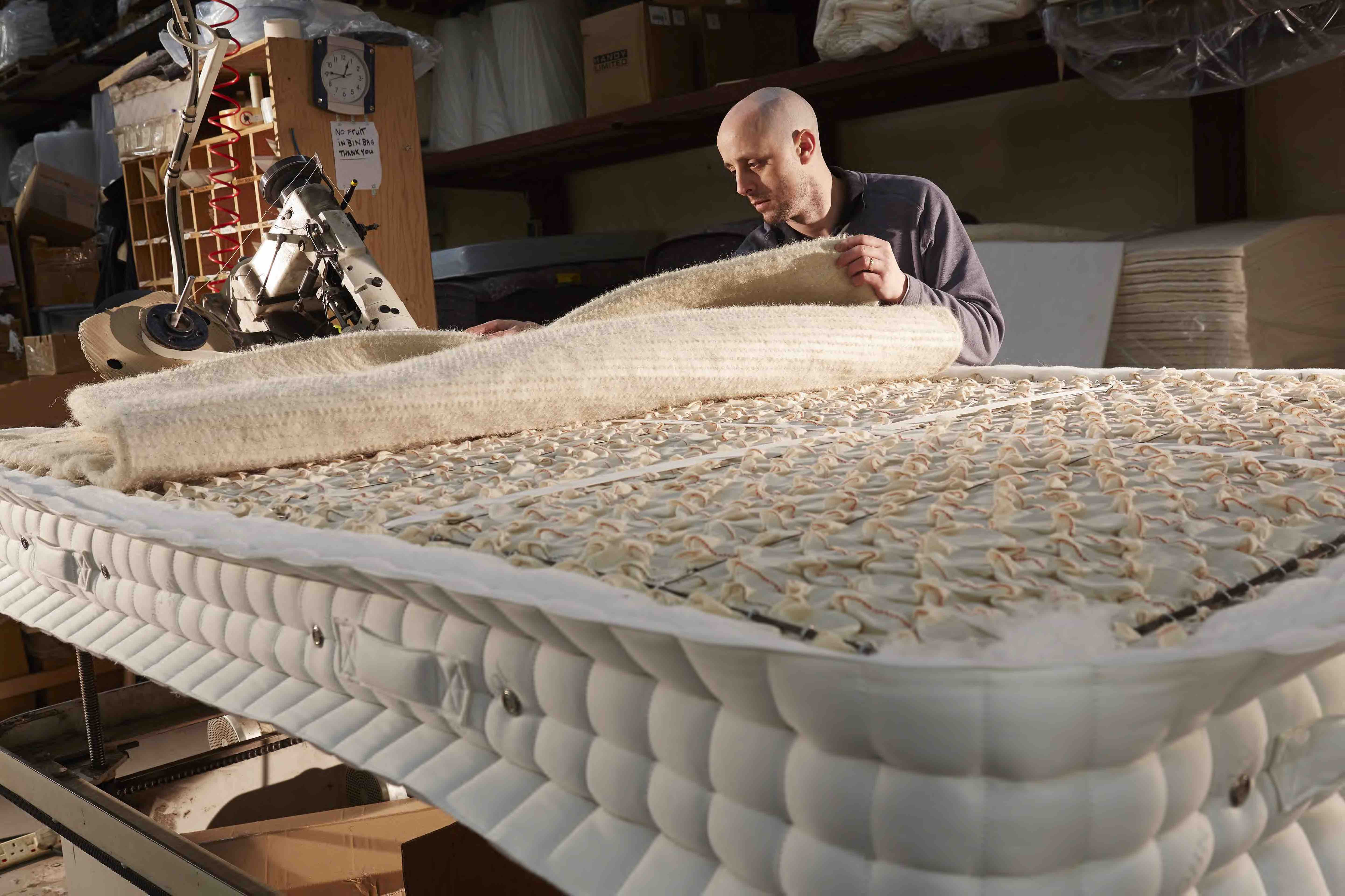Upholstery layers on top of the spring unit provide the 'comfort' feel to a mattress starting with the insulator