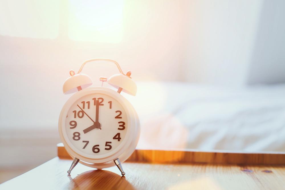 Alarm clock next to mattress