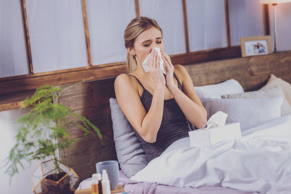 Woman sneezing on John Ryan mattress