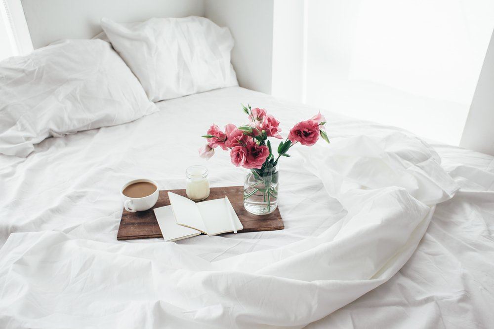 Bedroom flowers on White Duvet
