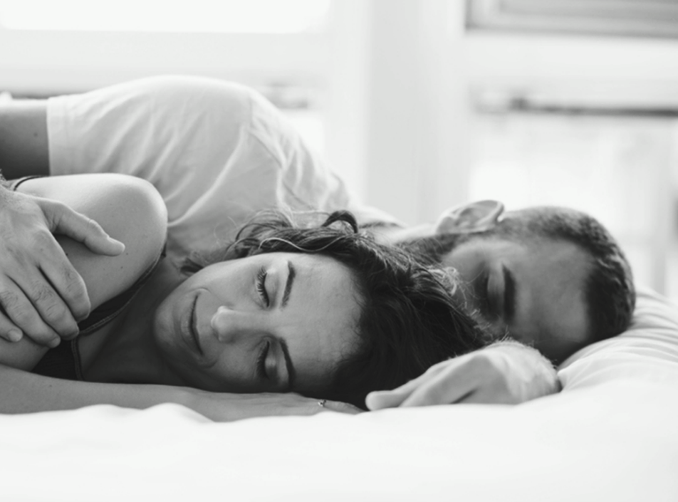 A sleeping couple in bed